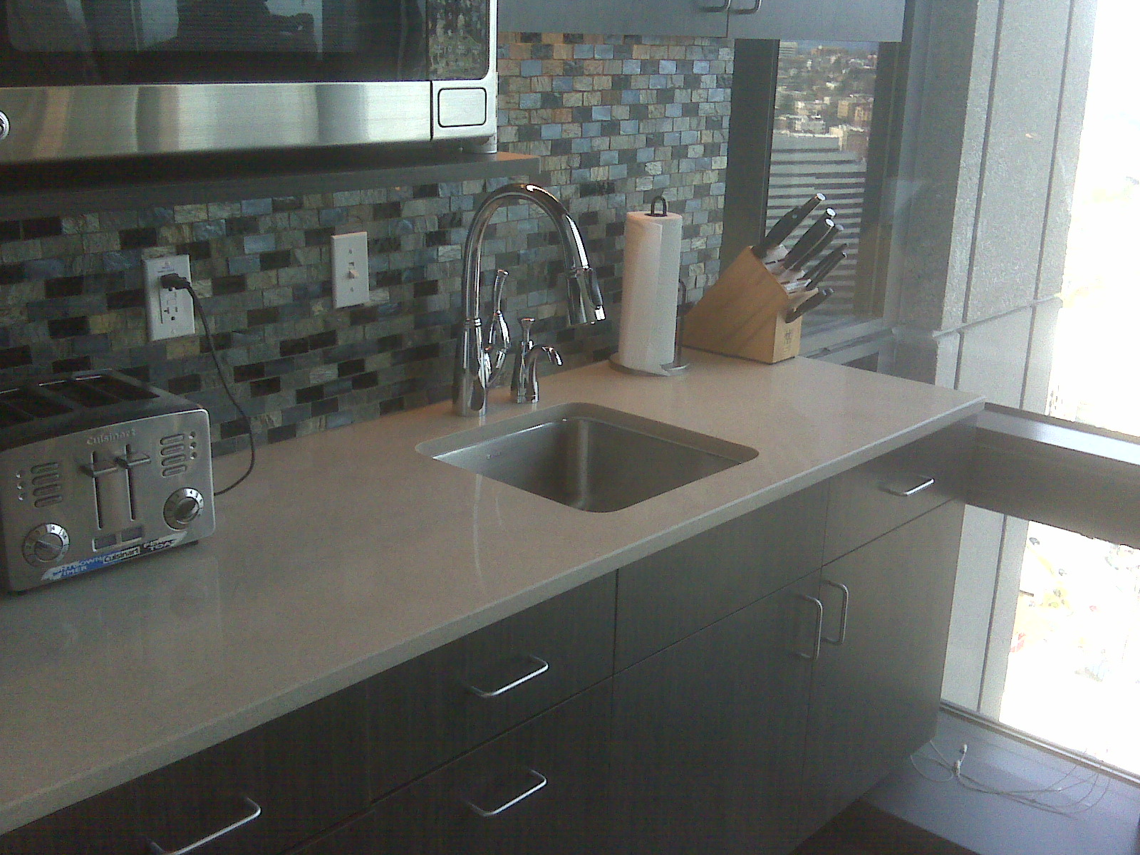 Dark cabinets light counter tile stainless and gray silverish backsplash home ideas kitchen Kitchen backsplash ideas pictures 2010